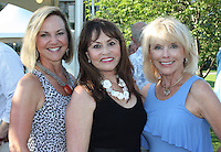 NWA Democrat-Gazette/CARIN SCHOPPMEYER Laura Underwood (from left), Athina McLendon and Jeanne Cole help support Washington Regional Hospice at the 25th annual Garden Party.