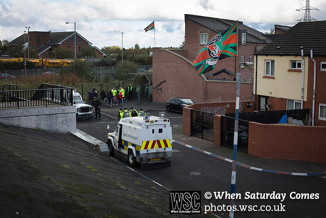 Glentoran 2 Cliftonville 1, 22/10/2016. The Oval, NIFL Premiership. Police Service of Northern Ireland officers on duty as away fans arrive at The Oval, Belfast before Glentoran hosted city-rivals Cliftonville in an NIFL Premiership match. Glentoran, formed in 1892, have been based at The Oval since their formation and are historically one of Northern Ireland's 'big two' football clubs. They had an unprecendentally bad start to the 2016-17 league campaign, but came from behind to win this fixture 2-1, watched by crowd of 1872. Photo by Colin McPherson.