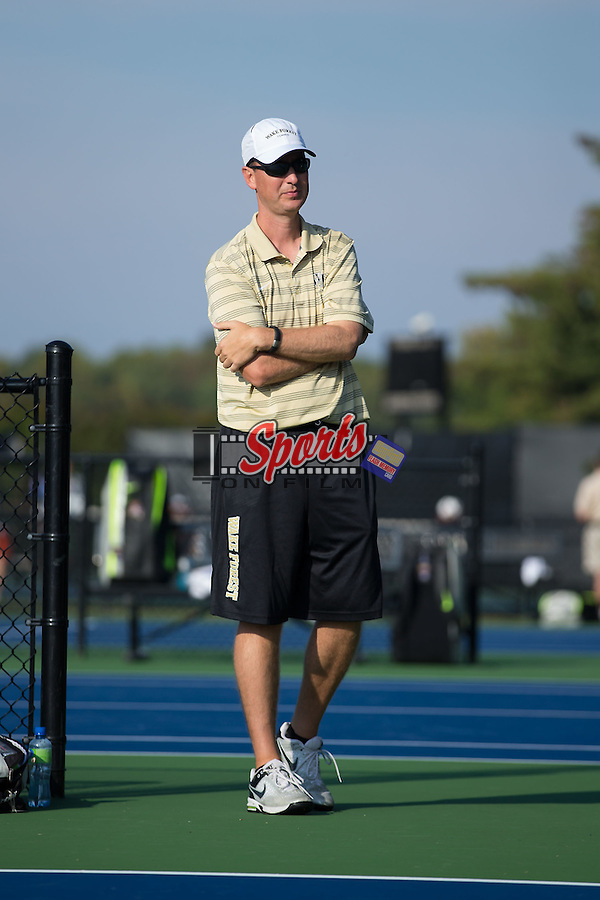 Wake Forest Demon Deacons head coach Jeff Wyshner watches the action during the Wake Forest Invitational at the Wake Forest Tennis Center on October 3, 2014 in Winston-Salem, North Carolina.  (Brian Westerholt/Sports On Film)