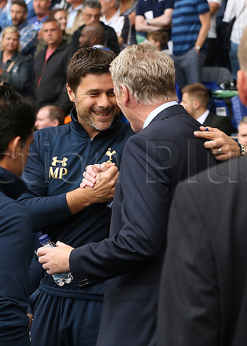 18.09.2016. White Hart Lane, London, England. Premier League Football. Tottenham Hotspur versus Sunderland. Tottenham Hotspur Manager Mauricio Pochettino greets Sunderland Manager David Moyes
