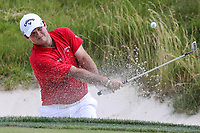 Bethesda, MD - July 1, 2017: Patrick Reed hits the ball out of the bunker during Round 3 of professional play at the Quicken Loans National Tournament at TPC Potomac in Bethesda, MD, July 1, 2017.  (Photo by Elliott Brown/Media Images International)