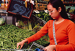 Collage student female shopping for vegetables: green beans at produce display