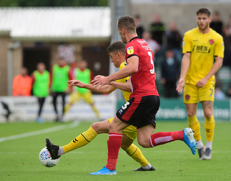Fleetwood Town's Harrison Biggins shields the ball from Lincoln City's Harry Toffolo<br /> <br /> Photographer Chris Vaughan/CameraSport<br /> <br /> The EFL Sky Bet League One - Lincoln City v Fleetwood Town - Saturday 31st August 2019 - Sincil Bank - Lincoln<br /> <br /> World Copyright © 2019 CameraSport. All rights reserved. 43 Linden Ave. Countesthorpe. Leicester. England. LE8 5PG - Tel: +44 (0) 116 277 4147 - admin@camerasport.com - www.camerasport.com