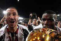 Calcio, finale Tim Cup: Milan vs Juventus. Roma, stadio Olimpico, 21 maggio 2016.<br /> Juventus&rsquo; Giorgio Chiellini, left, and Paul Pogba celebrate with the trophy at the end of the Italian Cup final football match between AC Milan and Juventus at Rome's Olympic stadium, 21 May 2016. Juventus won 1-0 in the extra time.<br /> UPDATE IMAGES PRESS/Isabella Bonotto