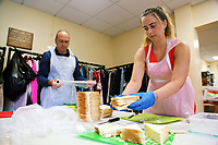 Pictured L-R: Deputy Council Leader Clive Lloyd and Linzi Isaac prepare cheese sandwiches at Jersey Park Pavilion in Swansea, UK. Friday 25 August 2017<br /> Re: Free food for children story, Swansea, Wales, UK.