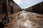 Muddy road in San Pedro de Atacama, Chile after rainfall.