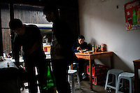 People eat breakfast in a small cafe in an old canal section of Shaoxing, Zhejiang, China.
