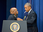 United States Representative John Lewis (Democrat of Georgia)l ,left, welcomes US President Barack Obama to the podium to make remarks at a session hosted by the White House Office of Public Engagement on strengthening and protecting the right to vote at the White House in Washington, DC on Thursday, August 6, 2015. The event was attended by civil rights leaders, faith leaders, voting rights activists and state and local officials.<br /> Credit: Ron Sachs / Pool via CNP