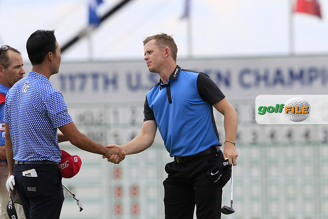 Kevin Na (USA) and Brandon Stone (RSA) finish on the 18th green during Saturday's Round 3 of the 117th U.S. Open Championship 2017 held at Erin Hills, Erin, Wisconsin, USA. 17th June 2017.<br /> Picture: Eoin Clarke   Golffile<br /> <br /> <br /> All photos usage must carry mandatory copyright credit (&copy; Golffile   Eoin Clarke)