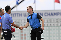 Kevin Na (USA) and Brandon Stone (RSA) finish on the 18th green during Saturday's Round 3 of the 117th U.S. Open Championship 2017 held at Erin Hills, Erin, Wisconsin, USA. 17th June 2017.<br /> Picture: Eoin Clarke | Golffile<br /> <br /> <br /> All photos usage must carry mandatory copyright credit (&copy; Golffile | Eoin Clarke)