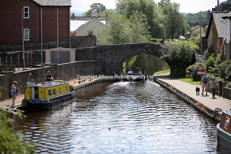 WEATHER PICTURE WALES<br />Pictured: A boat travelling in Brecon Canal, Wales, UK. Monday 18 July 2016<br />Re: Sunshine and high temperatures are due to affect most of the UK this week.