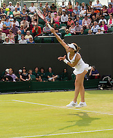 Andrea Petkovic<br /> <br /> Tennis - The Championships Wimbledon  - Grand Slam -  All England Lawn Tennis Club  2013 -  Wimbledon - London - United Kingdom - Wednesday 26th June  2013. <br /> &copy; AMN Images, 8 Cedar Court, Somerset Road, London, SW19 5HU<br /> Tel - +44 7843383012<br /> mfrey@advantagemedianet.com<br /> www.amnimages.photoshelter.com<br /> www.advantagemedianet.com<br /> www.tennishead.net