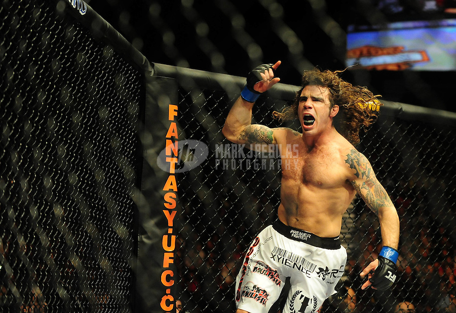 Jan. 31, 2009; Las Vegas, NV, USA; UFC fighter Clay Guida celebrates after defeating Nate Diaz (not pictured) during the lightweight bout in UFC 94 at the MGM Grand Hotel and Casino. Guida defeated Diaz on a split decision. Mandatory Credit: Mark J. Rebilas-