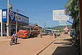 Pará State, Brazil. São Félix do Xingu. Dusty street with Bom Tempo supermarket.