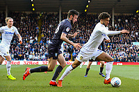 Leeds United's Tyler Roberts runs past Sheffield Wednesday's Morgan Fox<br /> <br /> Photographer Alex Dodd/CameraSport<br /> <br /> The EFL Sky Bet Championship - Leeds United v Sheffield Wednesday - Saturday 13th April 2019 - Elland Road - Leeds<br /> <br /> World Copyright © 2019 CameraSport. All rights reserved. 43 Linden Ave. Countesthorpe. Leicester. England. LE8 5PG - Tel: +44 (0) 116 277 4147 - admin@camerasport.com - www.camerasport.com