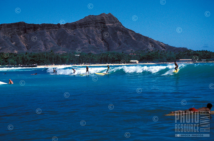 Surfing near famous Diamond head crater or Mount Leahi, Waikiki beach, Island of Oahu