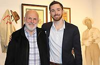 NWA Democrat-Gazette/CARIN SCHOPPMEYER John Tyson (left) and son John Randal Tyson attend the exhibition launch at the Art Center of the Ozarks Jan. 17.