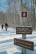 Star King Trail Sign with hikers in the background in Jefferson, New Hampshire USA