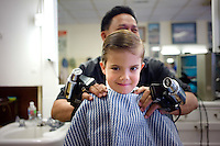 Callum Amidon gets a vibro-massage after haircut at Chuck's Barbershop in Denver.