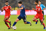 Minamino Takumi of Japan (C) is tackled by Harib Al Saadi (R) and Khalid Al Braiki of Oman (R) during the AFC Asian Cup UAE 2019 Group F match between Oman (OMA) and Japan (JPN) at Zayed Sports City Stadium on 13 January 2019 in Abu Dhabi, United Arab Emirates. Photo by Marcio Rodrigo Machado / Power Sport Images