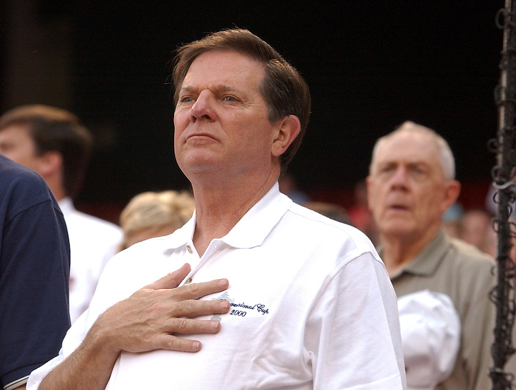 House Majority Leader Tom Delay, R-Texas, listen to the National Anthem, before the start of the 44th Annual Roll Call Congressional Baseball Game at RFK Stadium in Washington D.C.