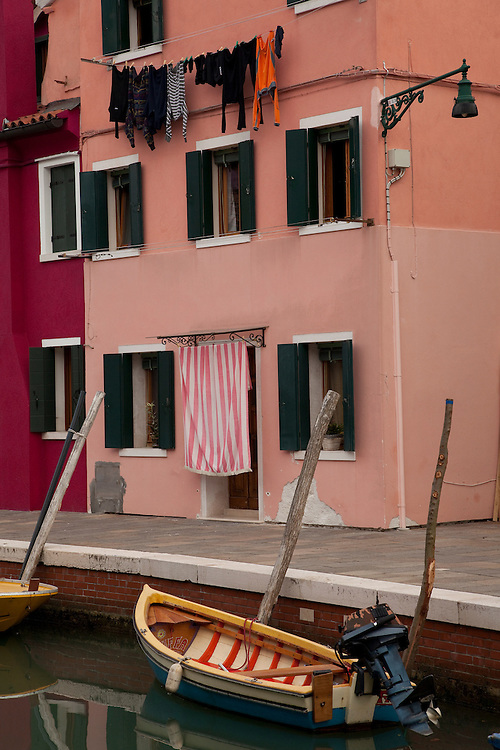 The island of Burano is known for it's brightly colored buildings alongside boat filled canals