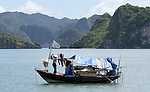 Halong-Vietnam, Ha Long - Viet Nam - 22 July 2005---Houseboat of a smallscale fisher(wo)man, at Halong Bay, a UNESCO World Natural Heritage Site---culture, tourism, landscape, nature, transport, housing, people---Photo: Horst Wagner/eup-images