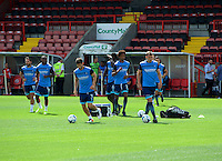 Wycombe Wanderers players warming up before the Sky Bet League 2 match between Crawley Town and Wycombe Wanderers at Broadfield Stadium, Crawley, England on 6 August 2016. Photo by Alan  Stanford / PRiME Media Images.