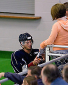 Nathan Gerbe signs autographs for some fans. -