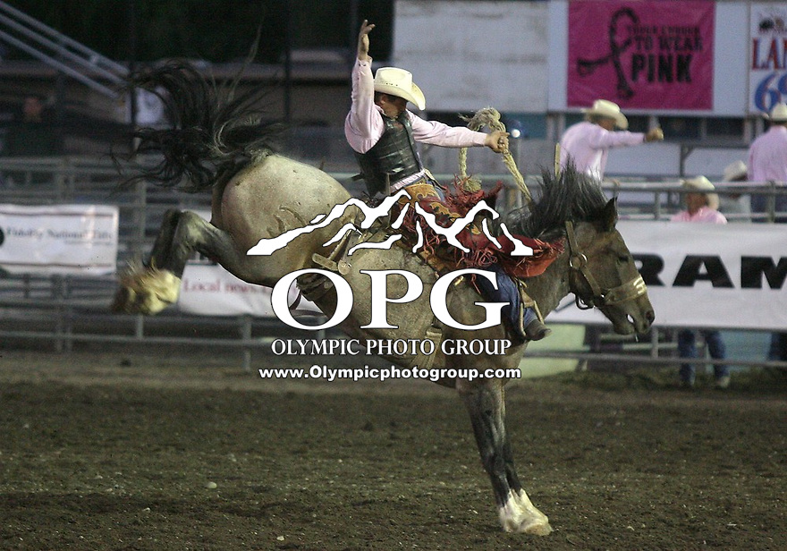 "28 Aug 2010:   Cody Wright scored a 84in the Saddle Bronc riding  competition at the Kitsap County Stampede Wrangle Million Dollar PRCA Silver Rodeo Tour Bremerton, Washington. Saturday night was ""TUFF ENOUGH TO WEAR PINK"" for support of Breast Cancer awareness."
