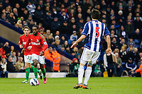Saturday, 9 March 2013<br /> <br /> Pictured: Angel Rangel of Swansea City and Nathan Dyer of Swansea City try to take the ball around Alan Tate of Swansea City<br /> <br /> Re: Barclays Premier League West Bromich Albion v Swansea City FC  at the Hawthorns, Birmingham, West Midlands