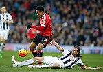 Jonas Olsson of West Bromwich Albion tackles Anthony Martial of Manchester United to concede a free kick - English Premier League - West Bromwich Albion vs Manchester Utd - The Hawthorns Stadium - West Bromwich - England - 6th March 2016 - Picture Simon Bellis/Sportimage