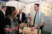 Christine O'Connor shares a laugh with Simon Shoulder of John A Stephens Builders Merchants