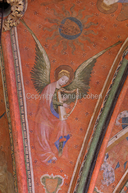 Fresco of an angel playing the harp, wings outstretched, 1380, attributed to Jan de Bruges, on the vaulted ceiling of the Chapelle de la Vierge or Chapel of the Virgin, in the Cathedrale Saint-Julien du Mans or Cathedral of St Julian of Le Mans, Le Mans, Sarthe, Loire, France. The frescoes were restored in the late 20th century. The cathedral was built from the 6th to the 14th centuries, with both Romanesque and High Gothic elements. It is dedicated to St Julian of Le Mans, the city's first bishop, who established Christianity in the area in the 4th century AD. Picture by Manuel Cohen