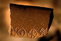 This is the only known stone vessel fragment with inscribed Indus script. It probably dates the the final phases of the Indus occupation, circa 2000-1900 BC...4,800 years ago, at the same time as the early civilizations of Mesopotamia and Egypt, great cities arose along the flood plains of the Indus and Saraswati (Ghaggar-Hakra) rivers.  Developments at Harappa have pushed the dates back 200 years for this civilization, proving once and for all, that this civilization was not just an offshoot of Mesopotamia..They were a highly organized and very successful civilization.  They built some of the world's first planned cities, created one of the world's first written languages and thrived in an area twice as large as Egypt or Mesopotamia for 900 years (1500 settlements spread over 280,000 square miles on the subcontinent)..There are three major communities--Harappa, Mohenjo Daro, and Dholavira. The town of Harappa flourished during this period because of it's location at the convergence of several trade routes that spanned a 1040 KM swath from the northern mountains to the coast.