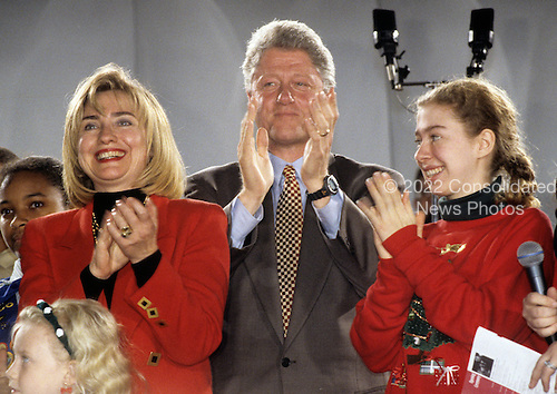 First lady Hillary Rodham Clinton, left, United States President Bill Clinton, and Chelsea Clinton sing Christmas carols at the lighting of the National Christmas Tree to open the annual Pageant of Peace on the Ellipse in Washington, D.C. on December 5, 1994.<br /> Credit: Ron Sachs / CNP