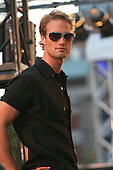 Le Chateau fashion show held in Montreal, Canada, male model wearing a black shirt and sunglasses