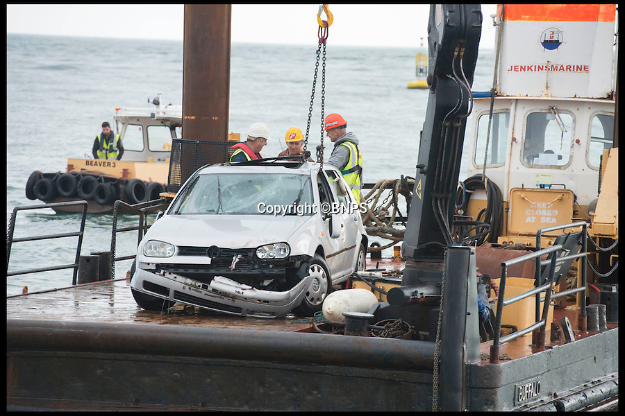 BNPS.co.uk (01202 558833)<br /> Pic: LauraDale/BNPS<br /> <br /> The car, safely rescued.<br /> <br /> An elderly woman has today been rescued from her sunken car after she 'deliberately' drove into a harbour in front of stunned day-trippers.The motorist, aged in her 70s, wound down both windows of her Volkswagen Golf before speeding down a ferry slipway and into the water.As the silver car was swept 100 yards out to sea by the fast tide the woman sat motionless in the flooded driver's seat, ignoring cries from witnesses on the quayside to get out.A brave crew member of a passing fishing boat then dived into the water and pulled the woman free just moments before her vehicle completely sank.