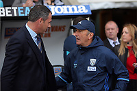 (L-R) Swansea manager Paul Clement greets West Bromwich manager Tony Pulis during the Premier League match between Swansea City and West Bromwich Albion at The Liberty Stadium, Swansea, Wales, UK. Sunday 21 May 2017