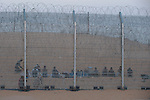 Eritrean immigrants are seen behind the newly-built fence in Israel-Egypt border, after they arrived a week earlier at the spot, crossed the old fence but got trapped by the new one. Israeli soldiers have been providing the group with water, but not allowing them into Israel.<br /> After eight days, Israeli government allowed entrance for two women and one youth, while the rest of men returned into Egyptian soil.