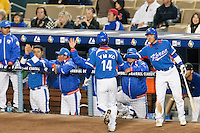 21 March 2009: #14 Young Min Ko of Korea celebrates with teammates after scoring during the 2009 World Baseball Classic semifinal game at Dodger Stadium in Los Angeles, California, USA. Korea wins 10-2 over Venezuela.