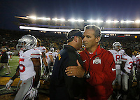 Ohio State Buckeyes head coach Urban Meyer, right, and California Golden Bears head coach Sonny Dykes, left, shake hands after the NCAA football game at Memorial Stadium in Berkeley, California,  Saturday afternoon, September 14, 2013. The Ohio State Buckeyes defeated the California Golden Bears 52 - 34. (The Columbus Dispatch / Eamon Queeney)