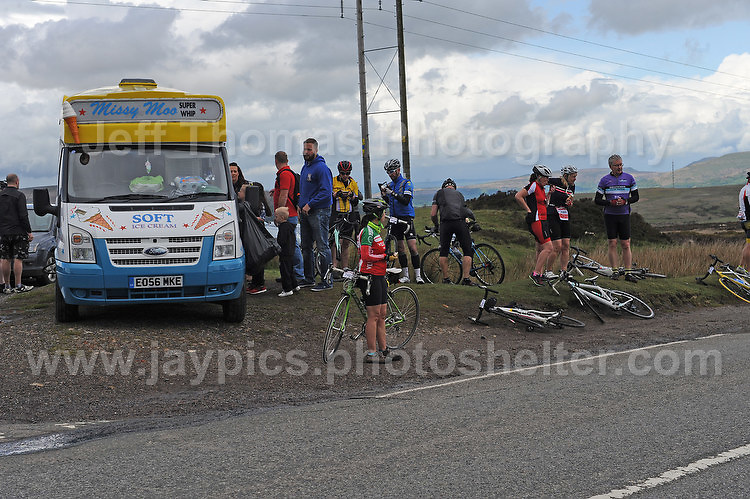 Competitors climb the challenging iconic and notorious 6km 10% stretch of road namely The Tumble during the Wales Velothon 2016 140km route cycling race.  Some go for ice cream as a refreshment. <br /> <br /> <br /> Jeff Thomas Photography -  www.jaypics.photoshelter.com - <br /> e-mail swansea1001@hotmail.co.uk -<br /> Mob: 07837 386244 -