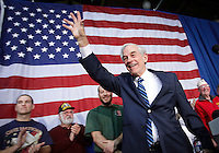 Ron Paul waves to supporters at the conclusion of a campaign speech during an evening rally in Des Moines, Iowa on December 28, 2011. (Christopher Gannon/MCT)