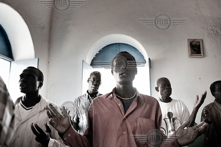 Agok, South Sudan. 20 March 2011...Believers during a Sunday mass in a church of the village of Agok, the western state of Bahr el Ghazal..