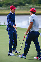 Jordan Spieth (USA) congratulates Patrick Reed (USA) for sinking his putt on 14 during round 3 Foursomes of the 2017 President's Cup, Liberty National Golf Club, Jersey City, New Jersey, USA. 9/30/2017.<br /> Picture: Golffile | Ken Murray<br /> <br /> All photo usage must carry mandatory copyright credit (&copy; Golffile | Ken Murray)