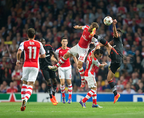 27.08.2014.  London, England. Champions League Qualifying 2nd Leg. Arsenal versus Besiktas. Arsenal's Mathieu Flamini takes a boot to the head during a challenge.