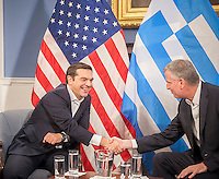 Greek Prime Minister Alexis Tsipras, left, in New York City Hall greets New York Mayor Bill de Blasio on Thursday, October 1, 2015. The PM and the Mayor exchanged pleasantries during a brief photo op for the press. The International Monetary Fund has been criticized for promoting its punishing austerity programs related to Greece's massive debt and weak economy.   (© Richard B. Levine)