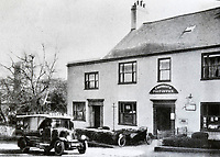 BNPS.co.uk (01202 558833)<br /> Pic: NormaCowan<br /> <br /> Charmouth PO on a previous site in the village in the 1920's.<br /> <br /> One of Britain's oldest post offices has permanently closed after 224 years due to the government's 'disgraceful and illogical' modernisation of the service.<br /> <br /> The popular branch, which was run by veteran postmasters Steve and Gill Pile, had served the seaside community of Charmouth in Dorset since 1795.<br /> <br /> But they have decided to retire after the Post Office Ltd insisted the post office was downsized and moved to another shop in the village under their 'Network Transformation Scheme'.<br /> <br /> Since Post Office Ltd have so far not been able to find an alternative venue, the village of 1,300 people is currently without a post office which also provided its only free cash point service - leaving some villagers 'in tears' and wondering how they will cope.
