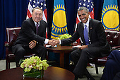 United States President Barack Obama (R) attends a bilateral meeting with President Nursultan Nazarbayev (L) of Kazakhstan at the United Nations Headquarters, New York, New York on September 29, 2015.  At far right is US Secretary of State John Kerry.<br /> Credit: Anthony Behar / Pool via CNP
